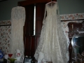 wedding dresses in dining room, east wall