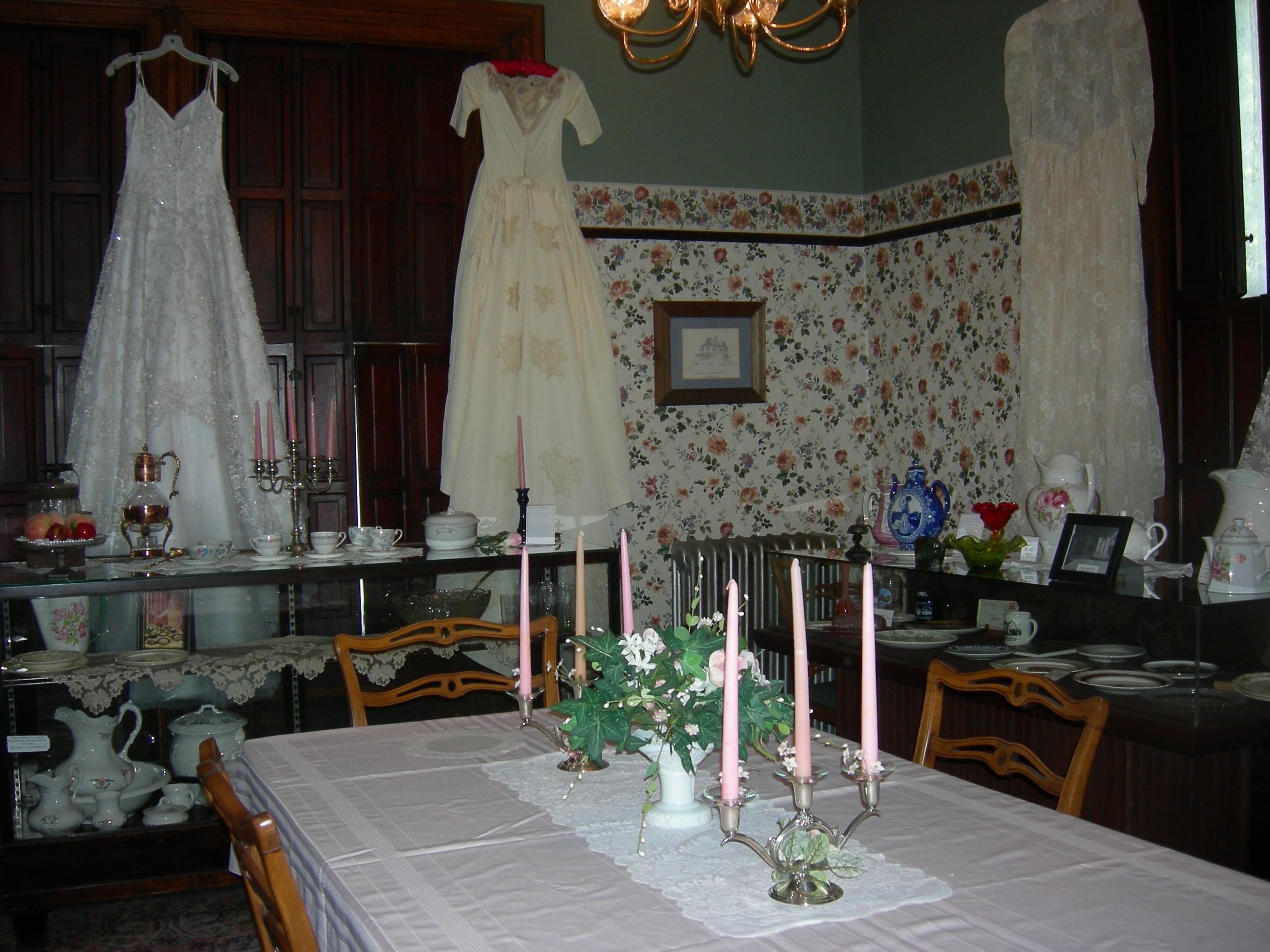 view of dining room with wedding dresses