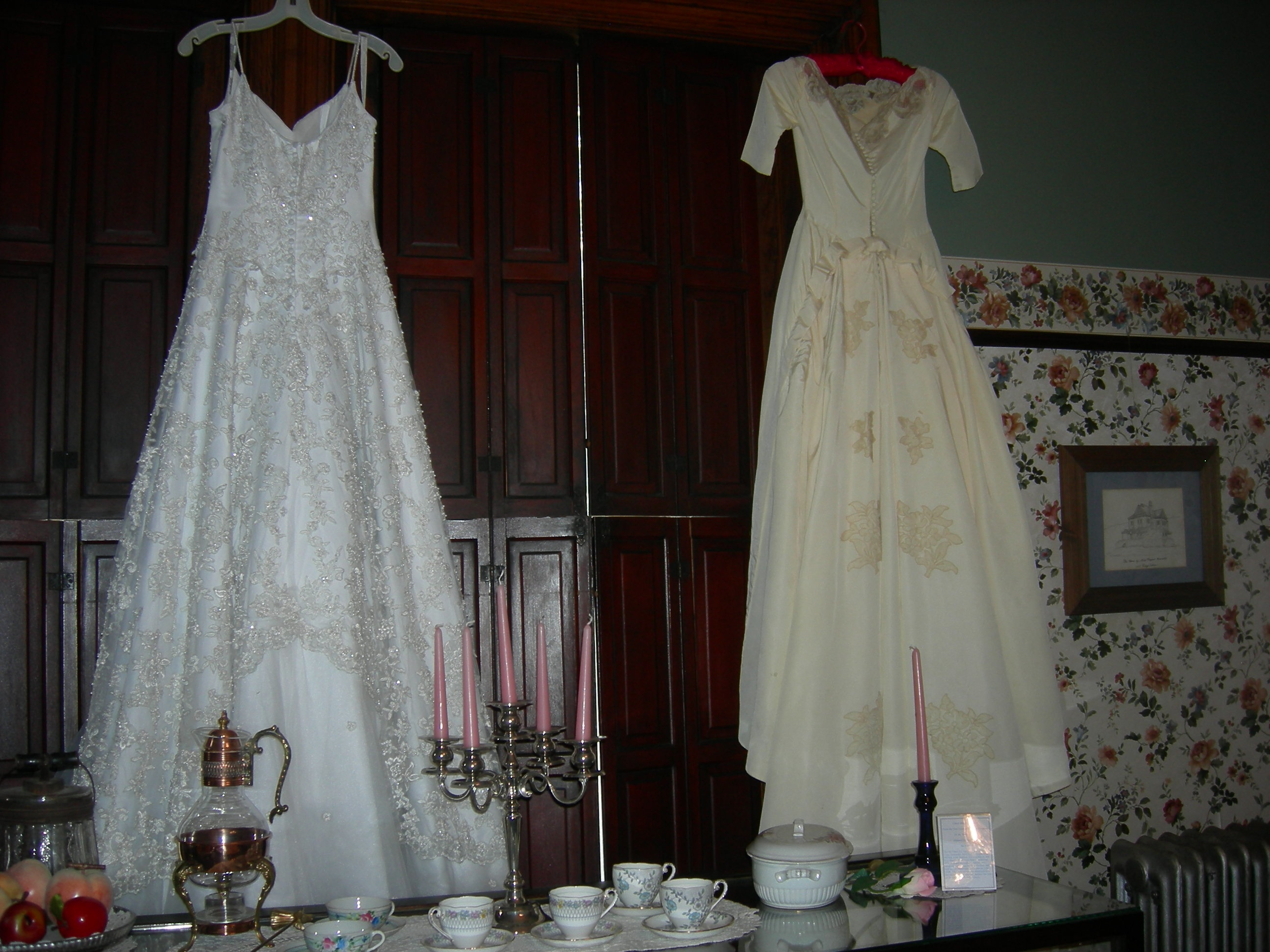 wedding dresses in dining room, south wall